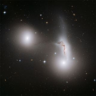 Trio of Galaxies Play Tug of War