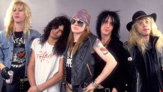 Guns N' Roses standing together in 1987
