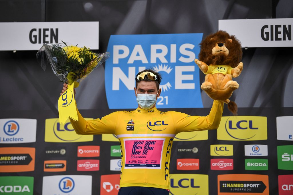 Team Education First rider Switzerlands Stefan Bissegger celebrates his overall leader yellow jersey on the podium after winning the 3rd stage of the 79th Paris Nice cycling race a 144km individual timetrial from Gien to Gien on March 9 2021 Photo by AnneChristine POUJOULAT AFP Photo by ANNECHRISTINE POUJOULATAFP via Getty Images