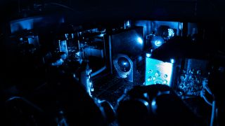 An internal photo shows the lasers of the Antihydrogen Laser Physics Apparatus (ALPHA) antimatter experiment at work.
