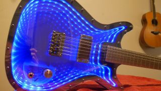 YouTuber Burls Art has built an infinity mirror guitar