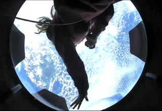 Hayley Arceneaux enjoying views from the tailor-made cupola in the Dragon Crew capsule.
