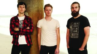 A press shot of Wild Throne taken in 2016, they are stood outside on a beach