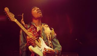 Jimi Hendrix performs live on stage playing a white Fender Stratocaster guitar with The Jimi Hendrix Experience at the Royal Albert Hall in London on 18th February 1969