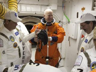 Shuttle commander Alan Poindexter trains for launch day.