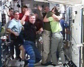 Shuttle Astronauts Prepare to Leave Station