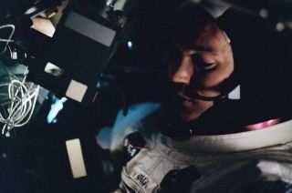 Michael Collins is seen aboard the command module Columbia on the first day of the Apollo 11 mission, July 16, 1969, while in transit to the moon for the first lunar landing.