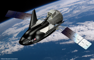 An artist's impression of the Dream Chaser space plane in orbit.