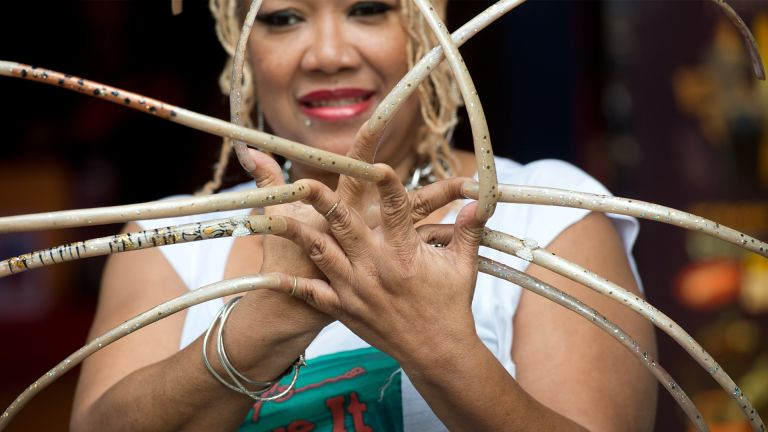 Ayanna Williams displays her 23 inch nails at the launch of Ripley's Believe It Or Not 2015 Annual in London. (Photo by Zak Hussein/Corbis via Getty Images)