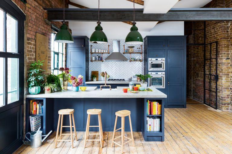 Dark blue open plan kitchen