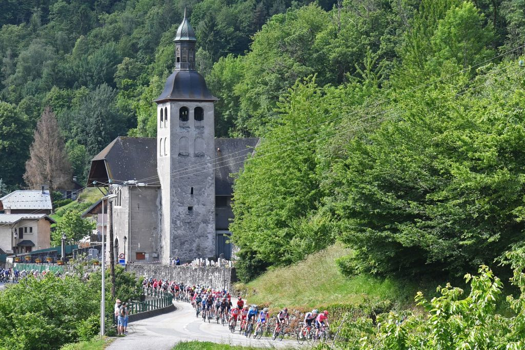 The pack rides during the eighth stage of the 73rd edition of the Criterium du Dauphine cycling race a 147km between La LechereLesBains and Les Gets on June 6 2021 Photo by Alain JOCARD AFP Photo by ALAIN JOCARDAFP via Getty Images
