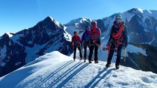 A photo from Rab's Facebook account of French climber Julia Virat leading a group across the Dômes de Miage