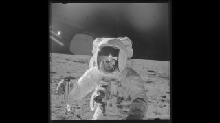 "An Apollo 12 astronaut takes ""moonshots"" with a Hasselblad camera."