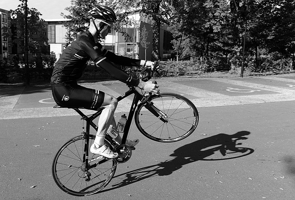 Ed Clancy pulls a wheelie, Rapha Condor Sharp training in Peak District, August 2011