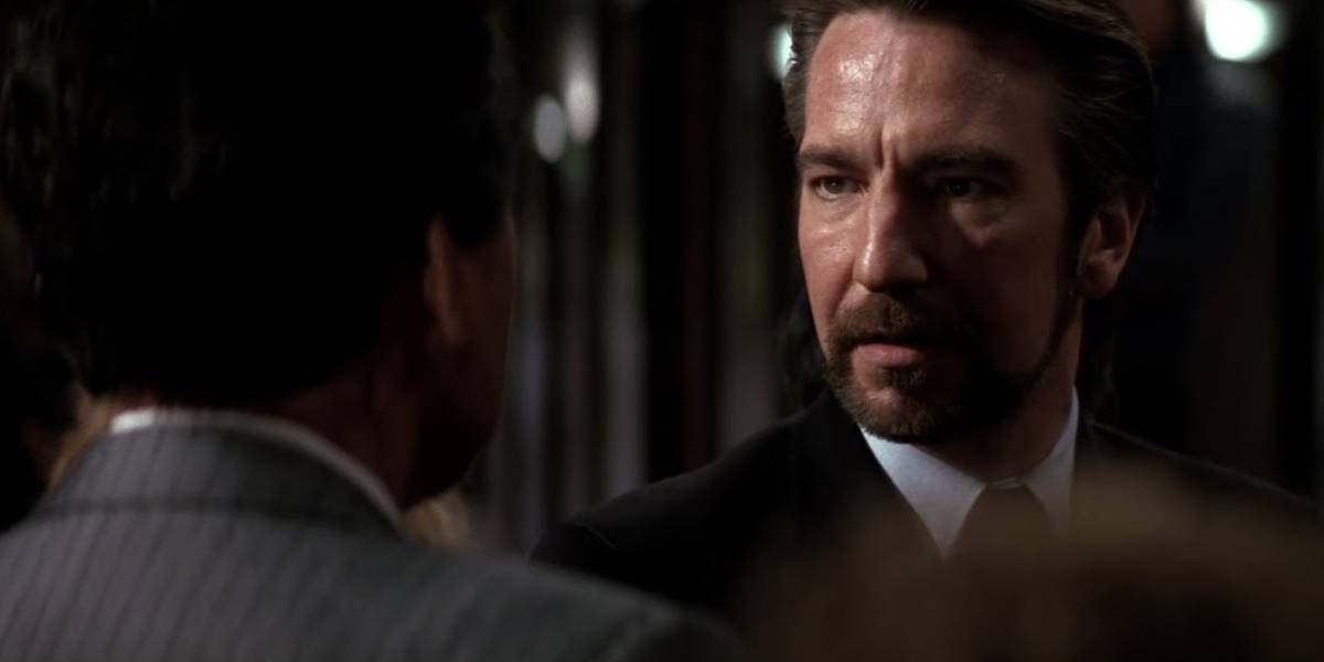 Alan Rickman as Hans Gruber meeting James Shigeta as Joseph Takagi in Die Hard