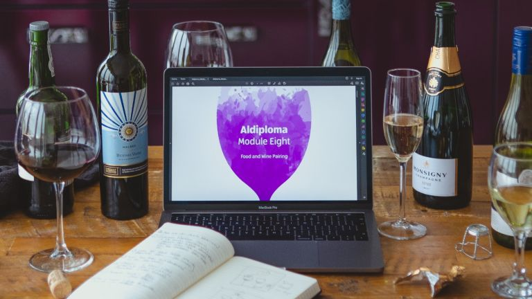 Aldi Wine School with wine bottles and laptop for learning modules