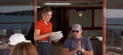 Chief Stew Katie brings plates for their charter guests after Lexi forgot them while taking pictures of the sunrise on the latest episode of 'Below Deck Mediterranean'.