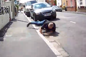 Motorist takes a tumble while trying to attack cyclist (video)