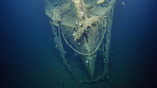 Researchers dive to the wreck of the WW II-era aircraft, the USS Independence.