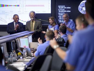 White House Science and Technology Advisor John Holdren (second from left) stops by the Mars Science Laboratory Mission Support Area on Aug. 5, 2012, at the Jet Propulsion Laboratory in Pasadena, California.