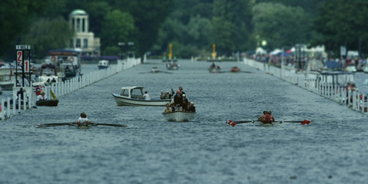 Two rowing teams race at the Henley Royal Regatta