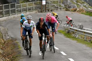 ALTODELANGLIRU SPAIN NOVEMBER 01 Hugh Carthy of The United Kingdom and Team EF Pro Cycling Richard Carapaz of Ecuador and Team INEOS Grenadiers Enric Mas Nicolau of Spain and Movistar Team White Best Young Jersey Aleksander Vlasov of Russia and Astana Pro Team Sepp Kuss of The United States and Team Jumbo Visma Primoz Roglic of Slovenia and Team Jumbo Visma Red Leader Jersey Daniel Martin of Ireland and Team Israel StartUp Nation Green Points Jersey Breakaway during the 75th Tour of Spain 2020 Stage 12 a 1094km stage from Pola de Laviana to Alto de lAngliru 1560m lavuelta LaVuelta20 La Vuelta on November 01 2020 in Alto de lAngliru Spain Photo by David RamosGetty Images