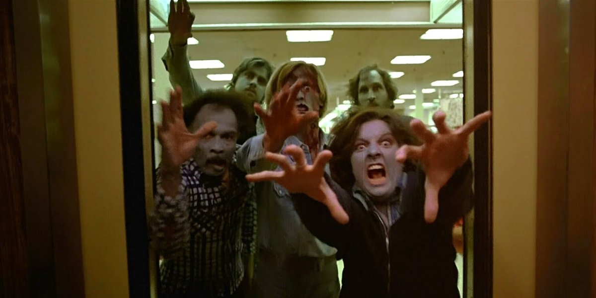 Hungry zombies reaching for Flyboy in Dawn of the Dead