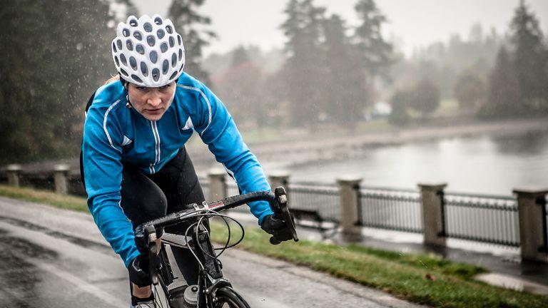Woman cycling in the rain