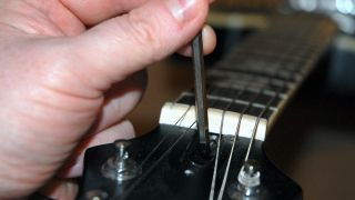 How to adjust an electric guitar's truss rod