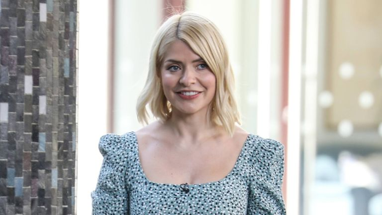 """Holly Willoughby's cute cream jumper, Holly Willoughby seen filming """"This Morning"""" on March 30, 2021 in London, England."""