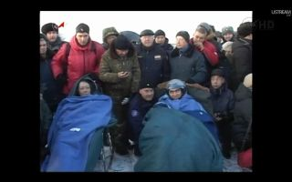 NASA astronaut Mike Fossum (left) and Russian cosmonaut (right) are pictured shortly after their Soyuz TMA-02M spacecraft touched down on the Central Asian steppes of Kazakhstan on Nov. 21, 2011.
