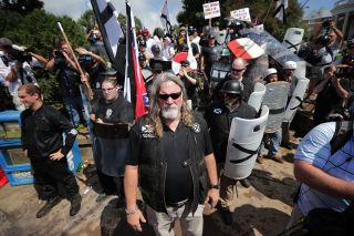 "White supremacists and neo-Nazis attempt to guard the entrance to Emancipation Park during the ""Unite the Right"" rally Aug. 12, 2017, in Charlottesville, Virginia."