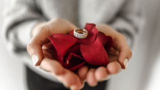 Ring presented on rose petals