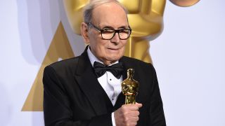 Ennio Morricone in 2016 with his Oscar for Best Original Score