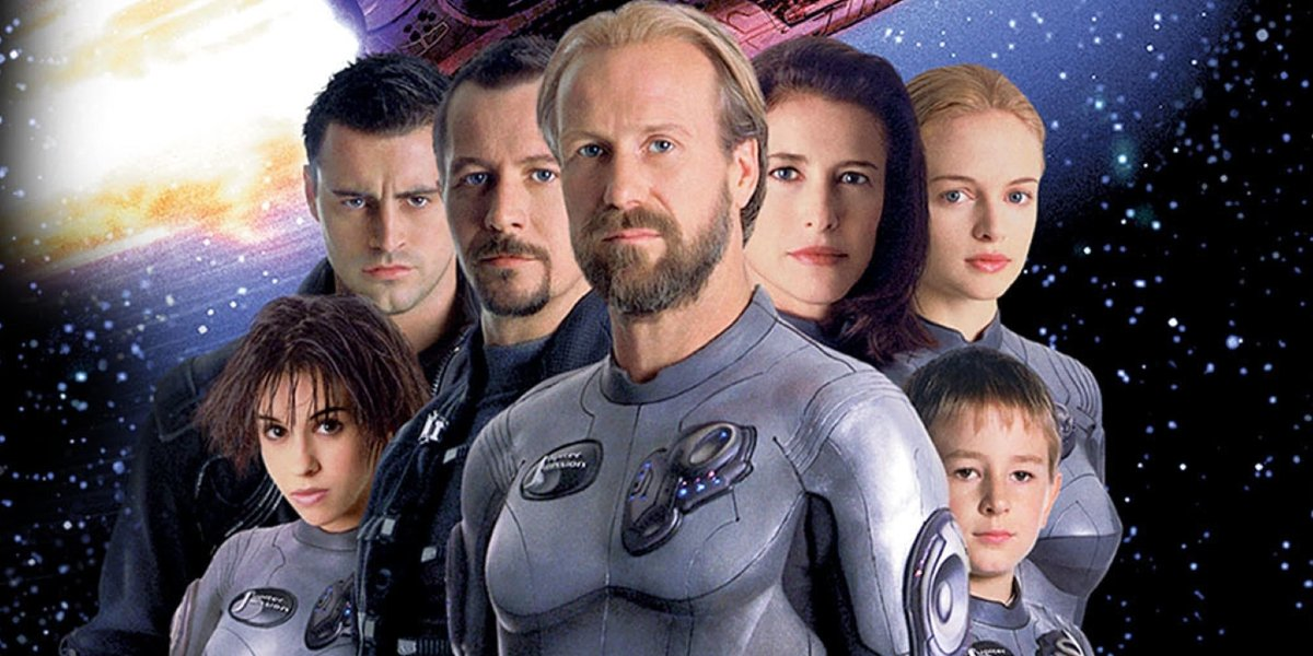 Lost in Space the full cast in front of the stars