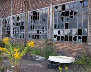 Broken windows in abandoned building