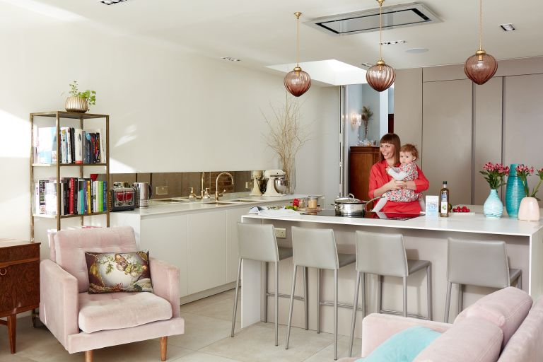 bright white kitchen with pink and earthy textures