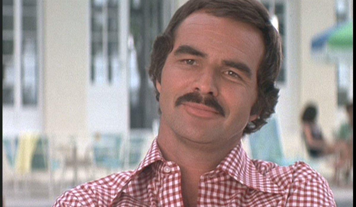 Gator Burt Reynolds sitting outside