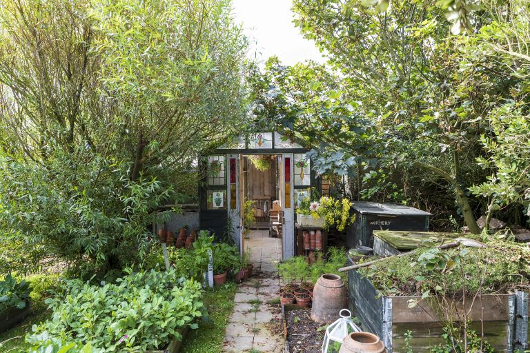 tarling greenhouse shed in flower garden