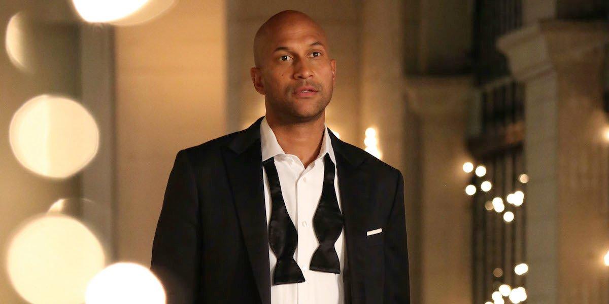 Keegan-Michael Key wearing tuxedo with bowtie untied
