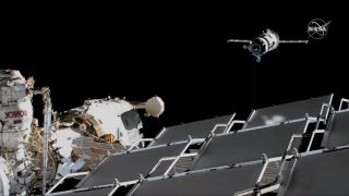 Soyuz commander Alexander Skvortsov of Roscosmos manually flew his Soyuz MS-13 spacecraft (right) from the Zvezda module of the International Space Station to a top -mounted Poisk module on Aug. 25, 2019.