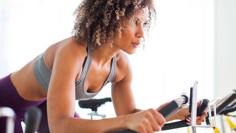 Woman enjoying the benefits of indoor cycling