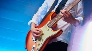 Man playing Fender Stratocaster electric guitar