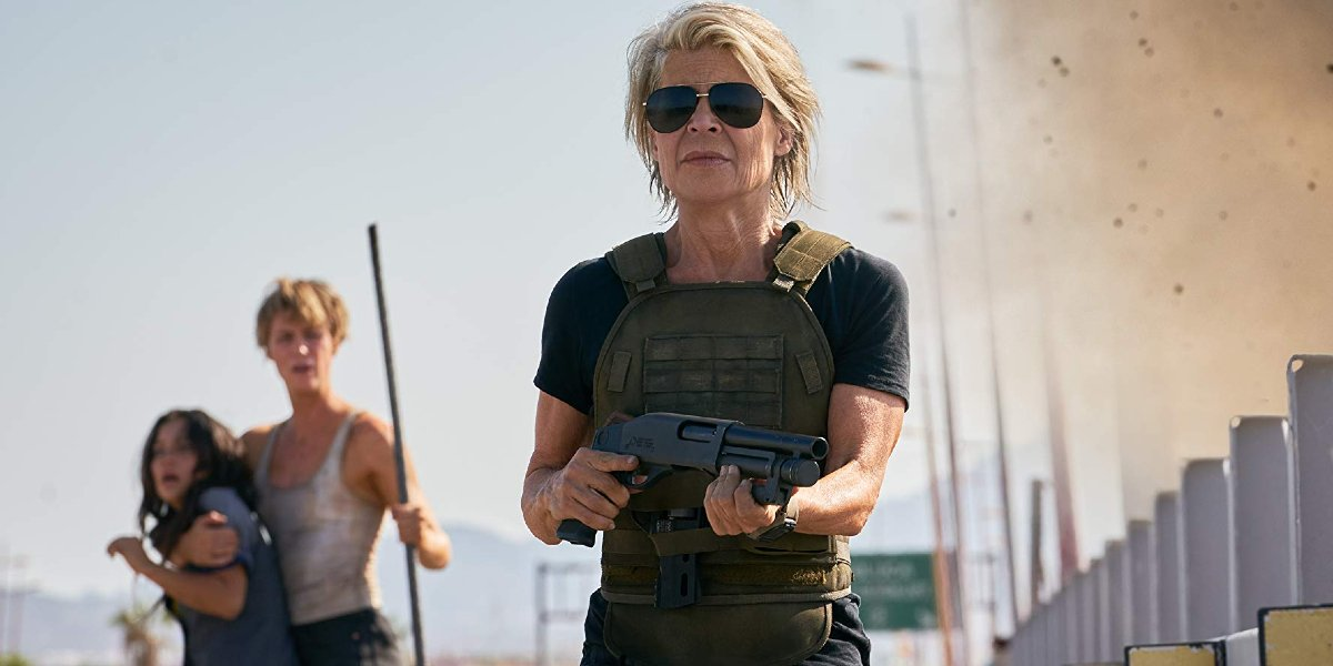 Terminator: Dark Fate Linda Hamilton walking with her shotgun in her hands