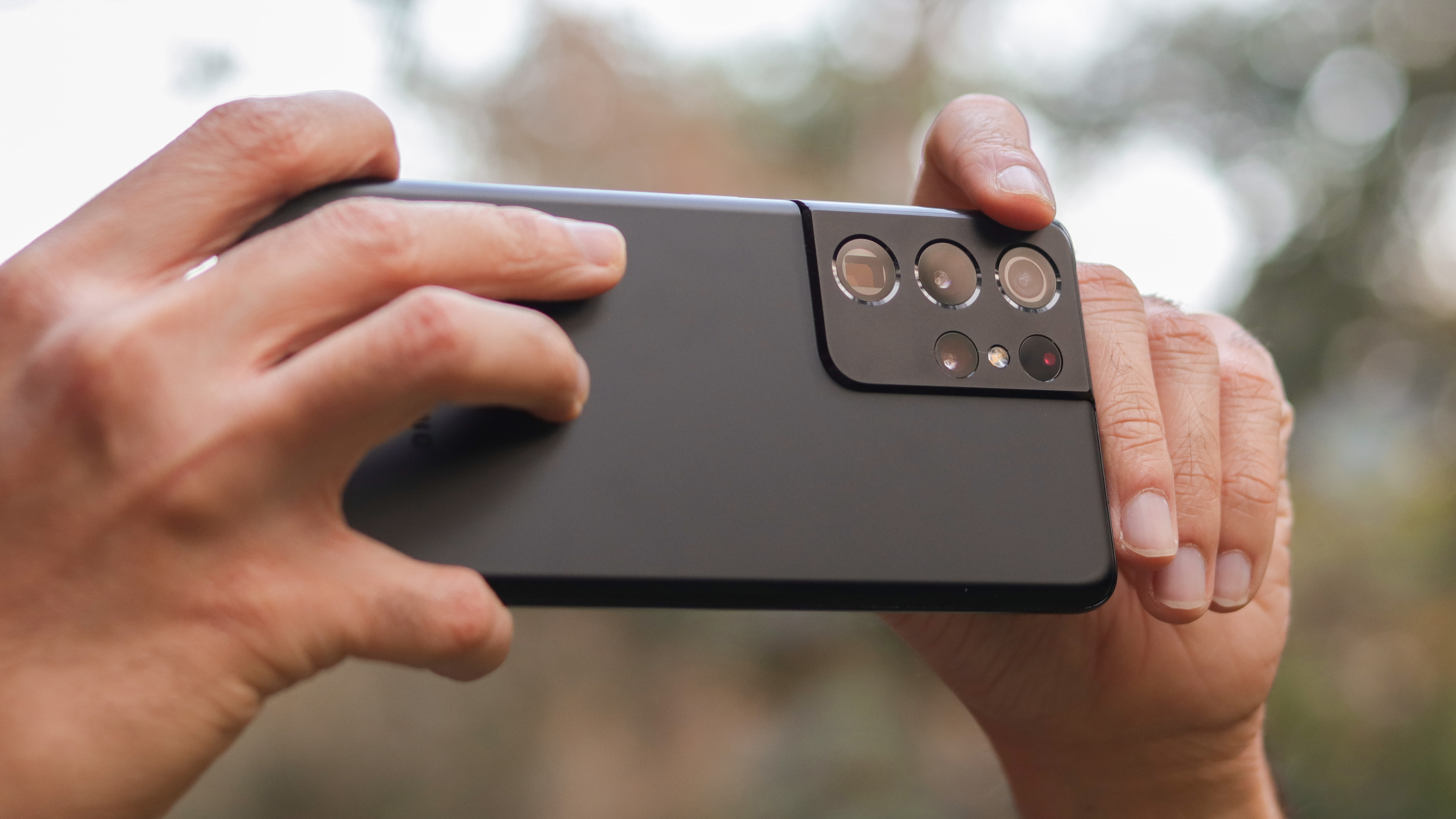A Samsung Galaxy S21 Ultra in black, viewed from the back