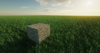 The ultra-realistic grass texture pack in Minecraft shown off next to a vanilla stone block.