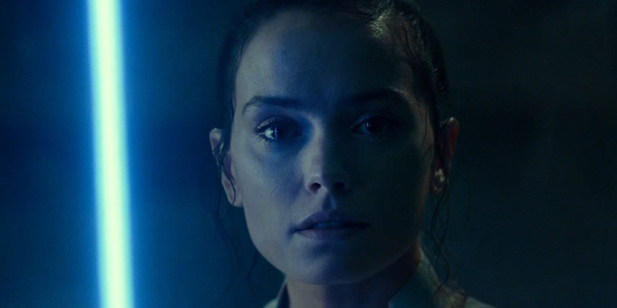 Star Wars: The Rise of Skywalker a somber Rey in the glow of her lightsaber