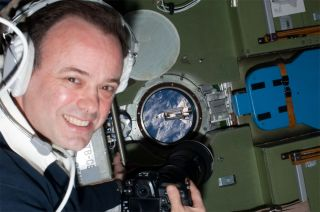 Astronaut Ron Garan on the International Space Station photographs the space shuttle.