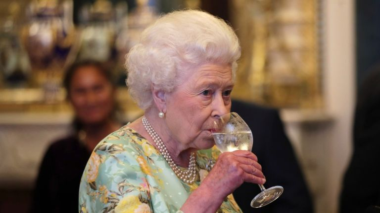 Queen Elizabeth II limited-edition rose petal gin, Queen Elizabeth II attends a reception for winners of The Queen's Awards for Enterprise, at Buckingham Palace on July 11, 2017 in London, England
