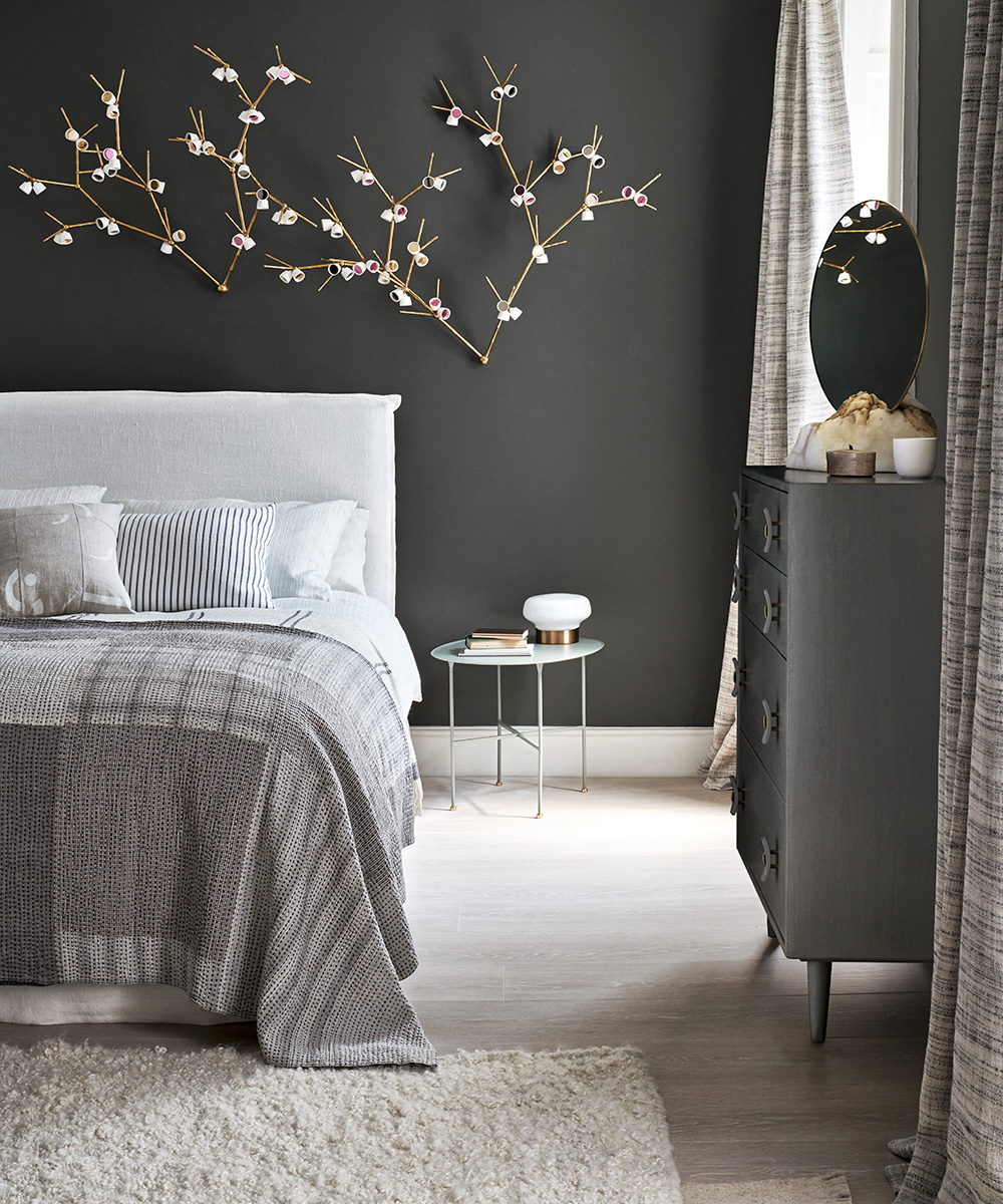 Bedroom with a dark feature wall and delicate details | Homes & Gardens